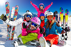 Family holiday children ski holiday ski trip